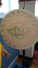 The green pegs on this board show how Su-Jin's visual field is concentrated to the lower left before vision therapy treatment.